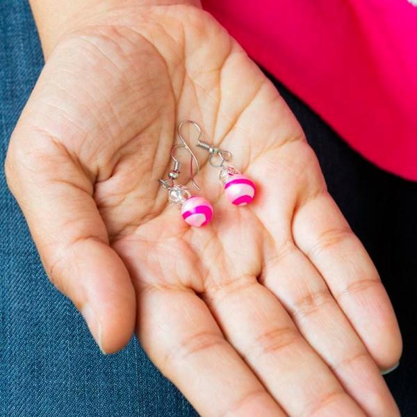 Hand showing swirl-hand-blown-glass-pink-silver-earrings-137