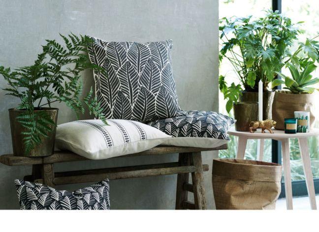 elementos naturales en decoración. Fundas de cojines con motivos de plantas