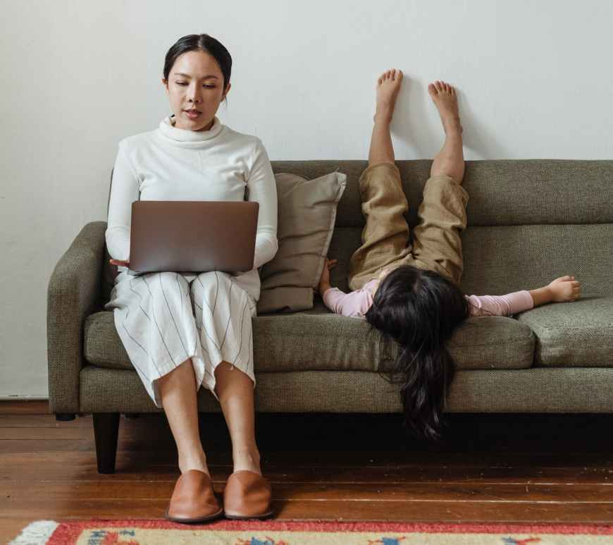 photo of mother working at home