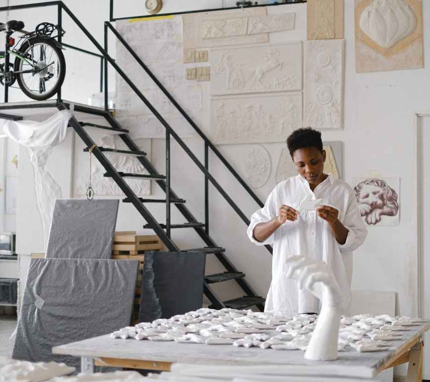 photo of woman doing ceramic sculpture