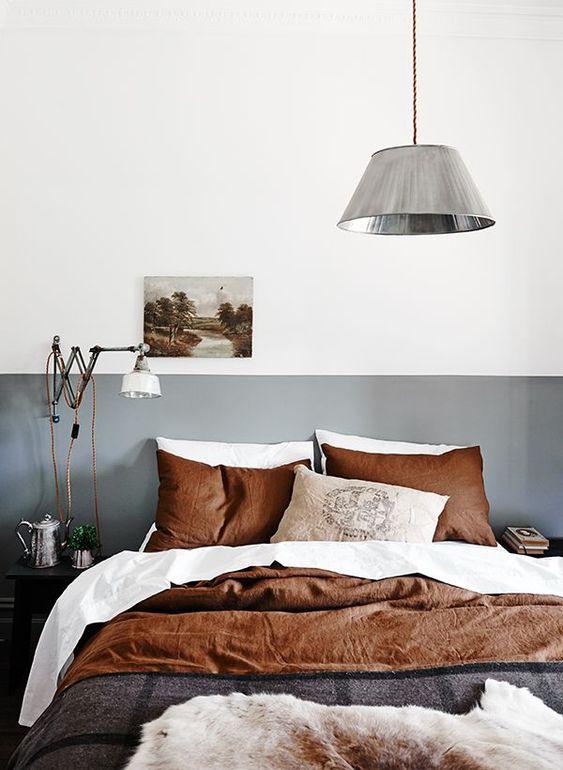 Colori caldi per i tessuti della camera da letto