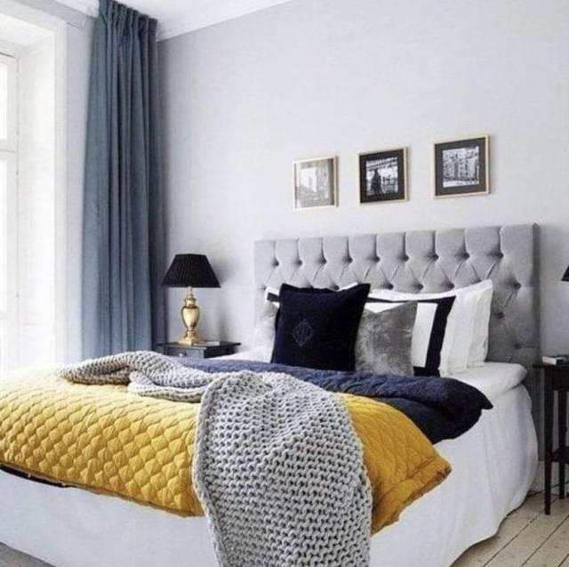 Tessili e dettagli di stile per una camera da letto in grigio e giallo