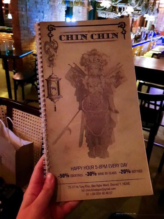 My hand holding the ChinChin Bar's menu.