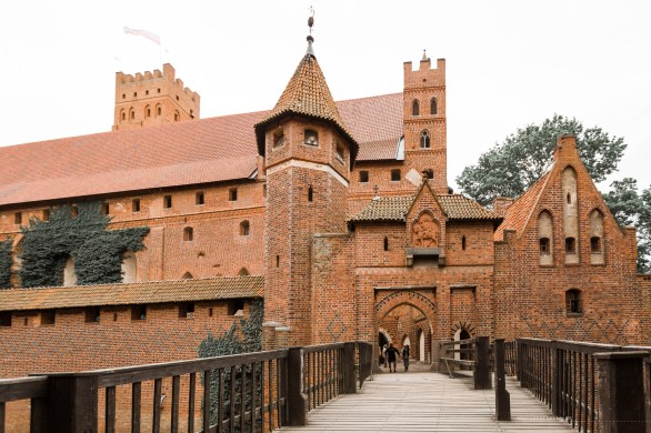 Entrance through a wooden bridge to one of the parts of the huge brick Malbork castle.