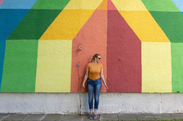 A very colourful part of one of the huge murals and me, trying to blend in with a slightly different shade of yellow/orange..