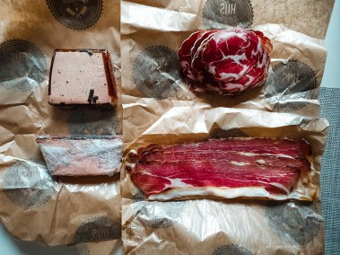 a top view photo of two pates and two hams purchased at one of the local markets.