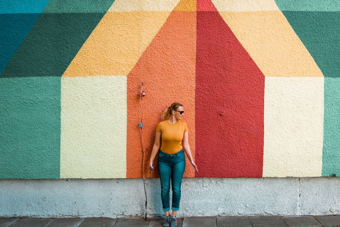 Me leaning against a colourful wall in Zaspa.