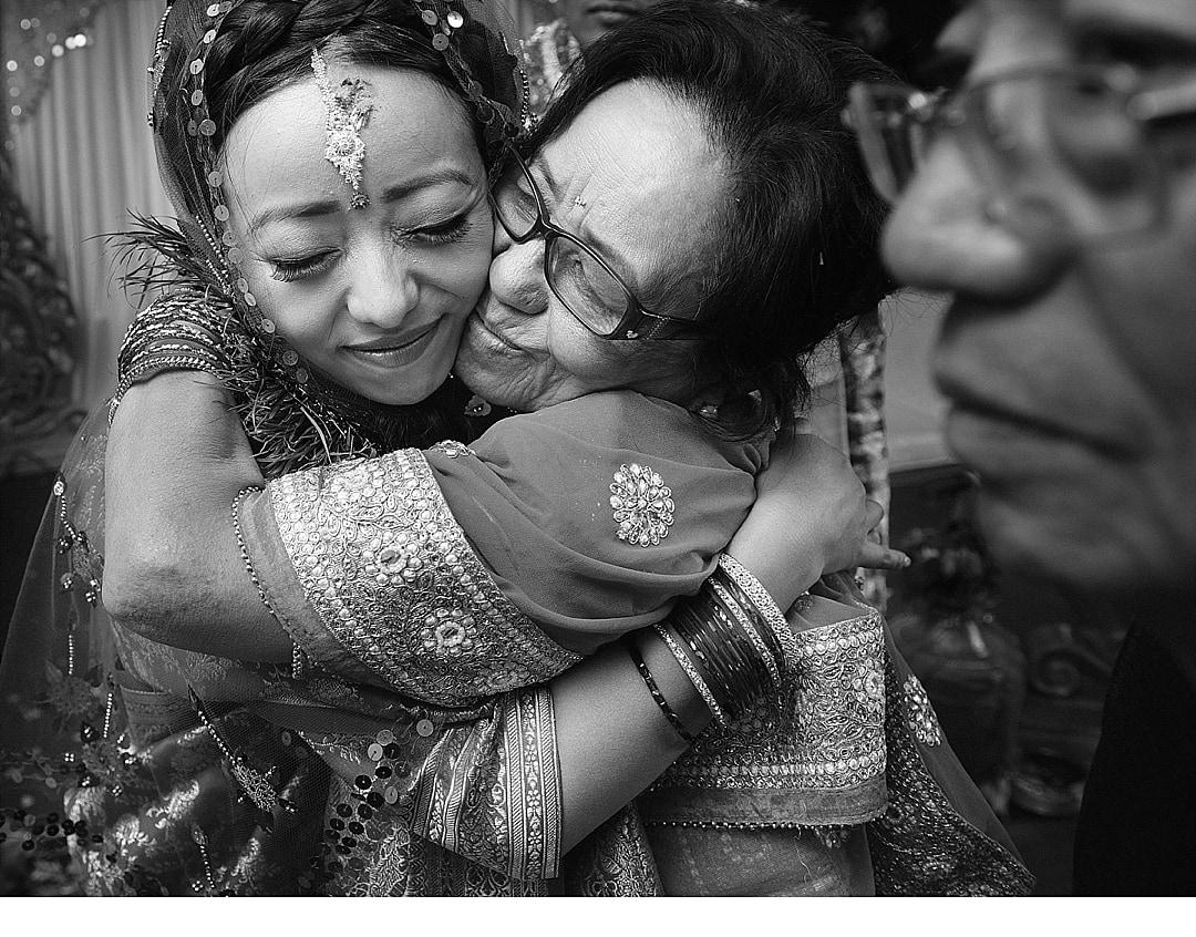 Froyle Park Wedding Photography Bride hugging her mum