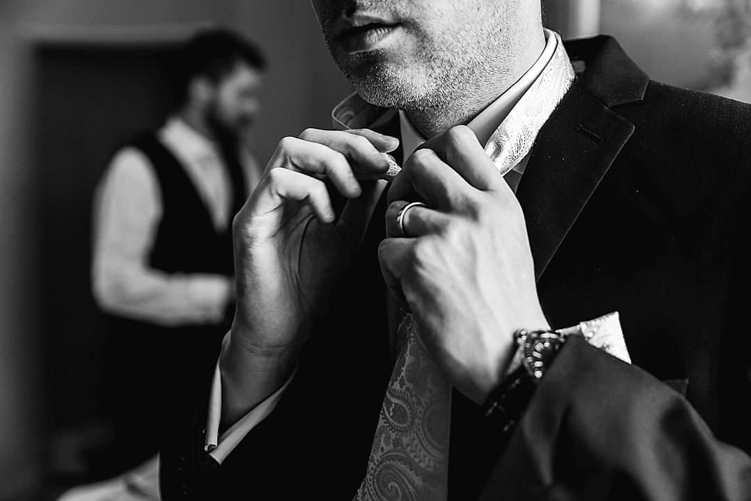 Corinthia Hotel Wedding Photographer Groom Prep at The Savoy London Tying a Tie