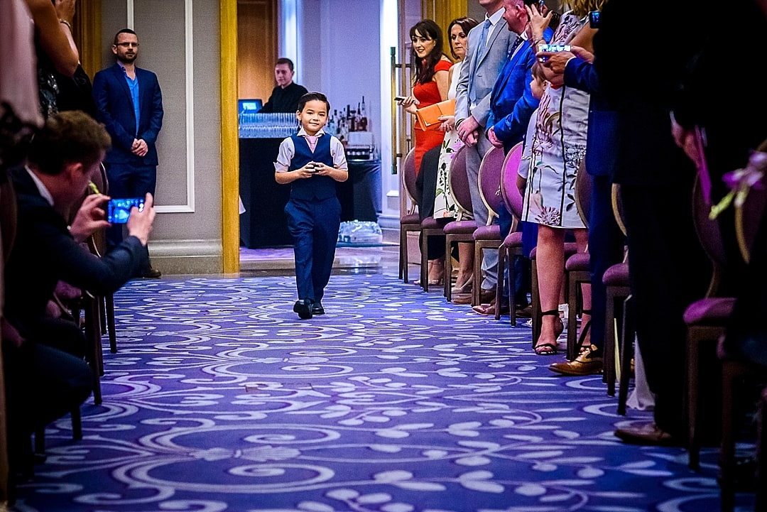 Corinthia Hotel Wedding Photographer page boy walking down the aisle