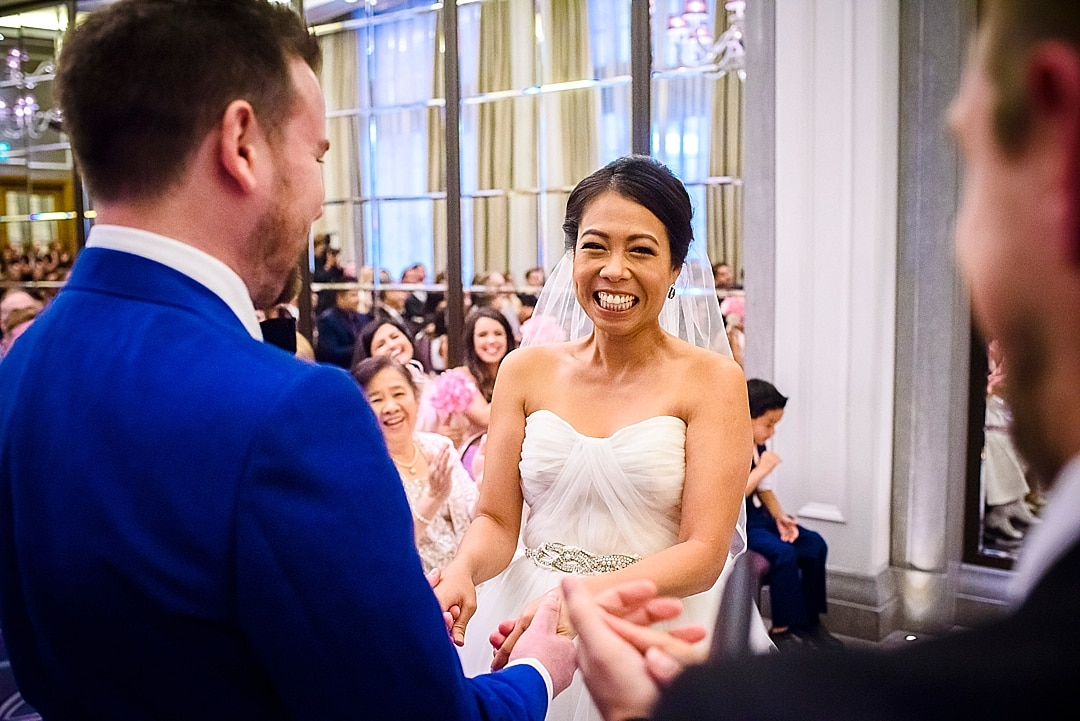 Corinthia Hotel Wedding Photographer Bride looking happy after wedding ceremony