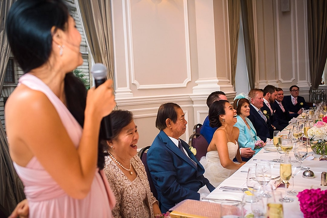 Corinthia Hotel Wedding Photographer bride laughing out loud during sister's speech