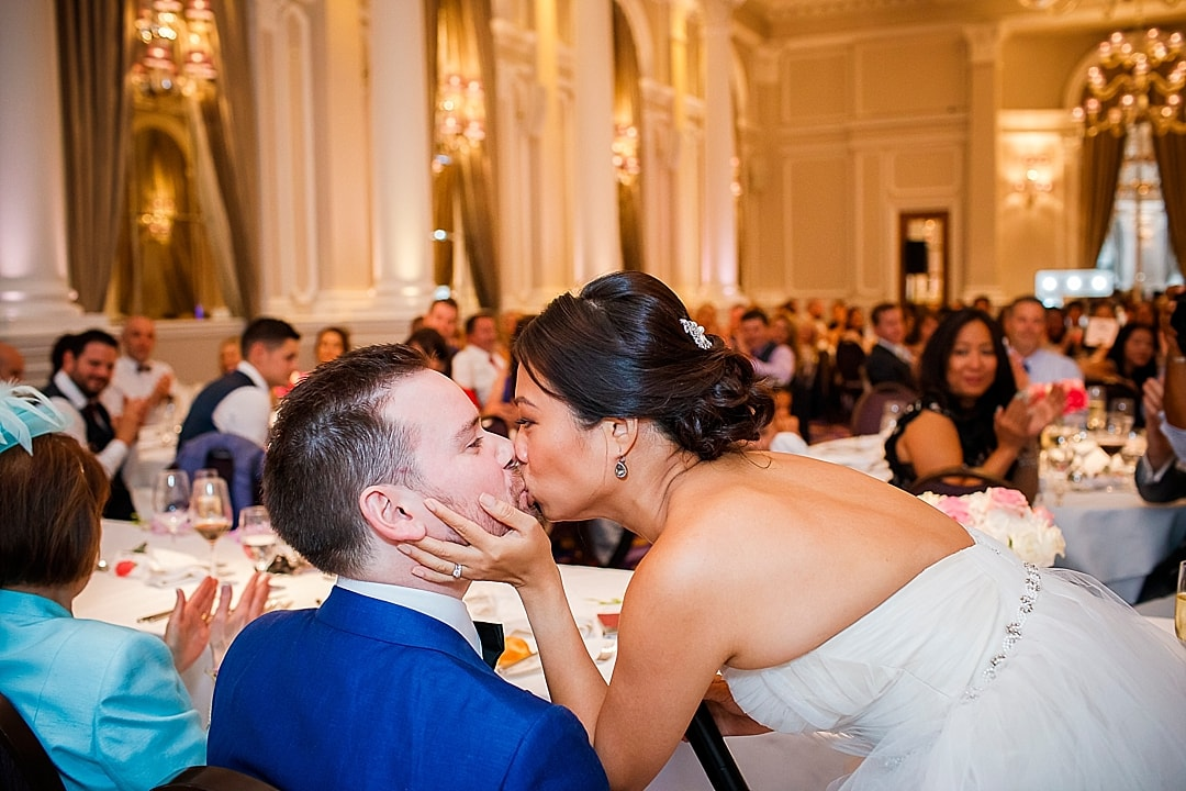 Corinthia Hotel Wedding Photographer bride and groom kiss during the speech