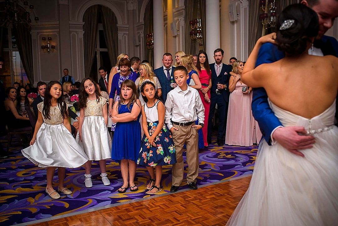 Corinthia Hotel Wedding Photographer children watching the first dance