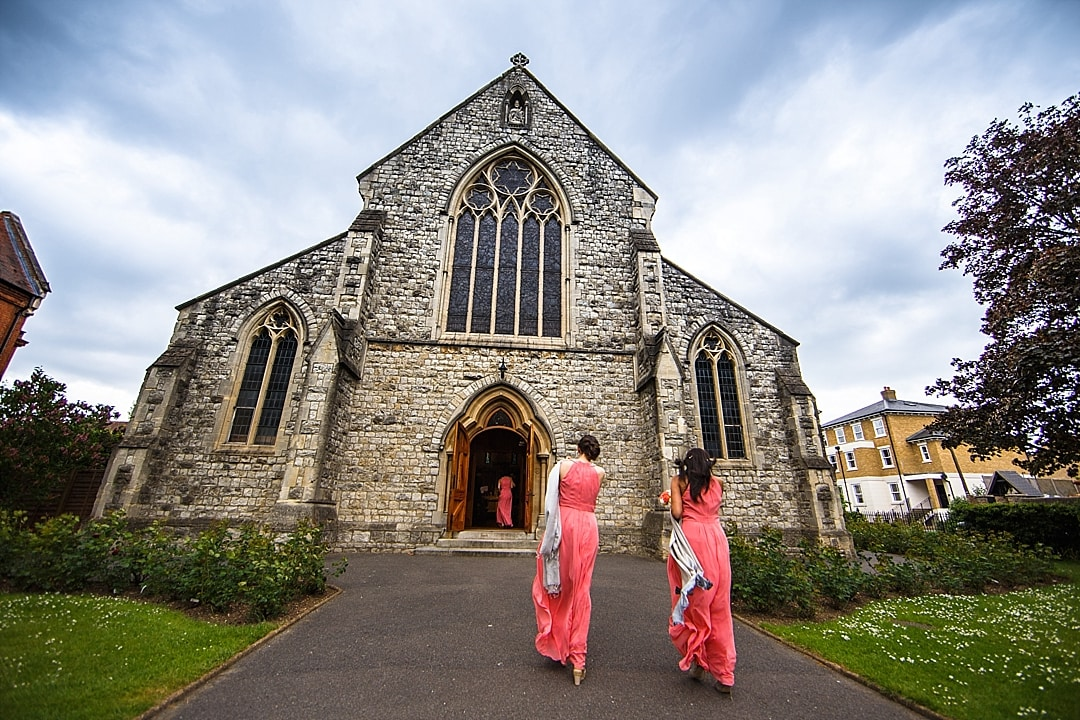 vill Court Wedding Photography Bridesmaids walking into the church