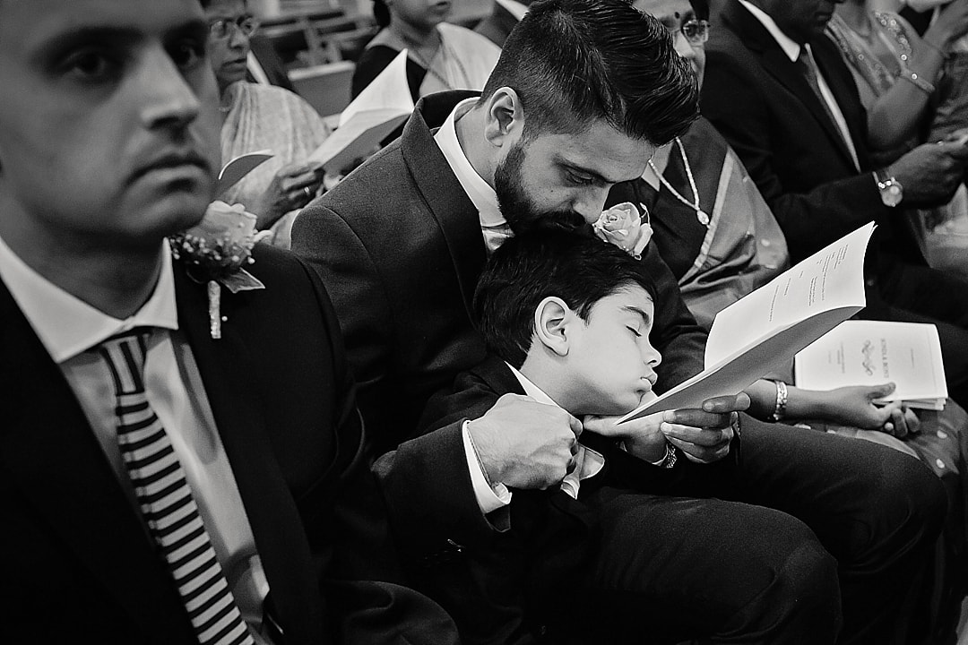vill Court Wedding Photography boy fast asleep during the wedding ceremony