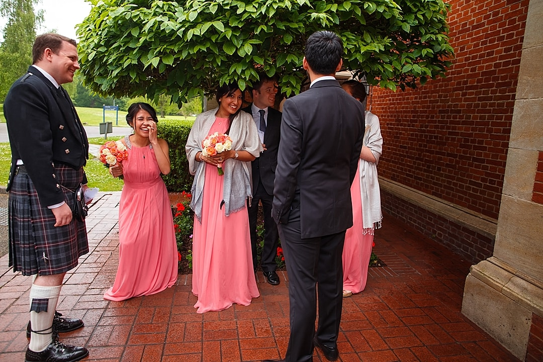 vill Court Wedding Photography Bridesmaids waiting in the rain