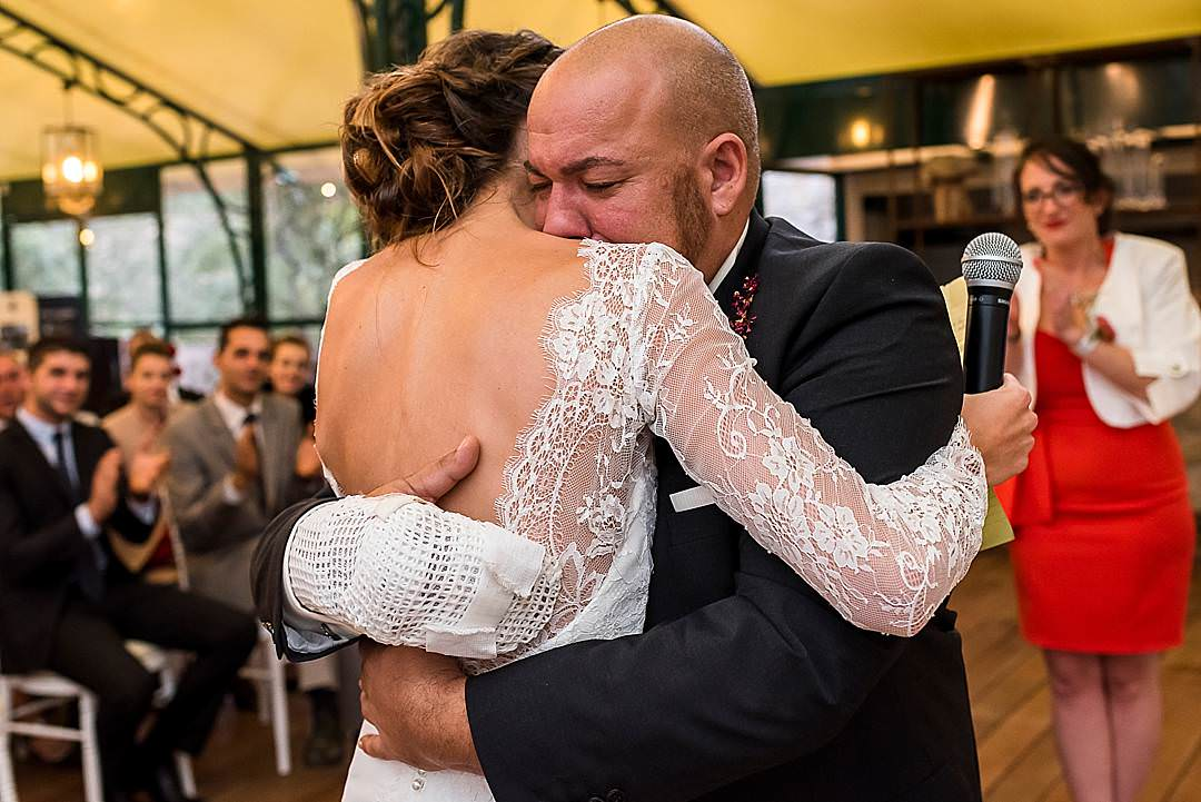 Chateau De Berne Reception Bride and Groom hugging crying