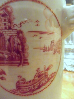 On this piece of late 18th Century Chinese porcelain a town appears to be in flames on the right while a fort appears on the left. Is this an American battle scene?
