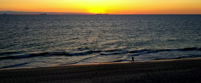 """""""Freo"""" as West Aussies foldly refer to Fremantle has the most beautiful beaches. A late finish to work today and I was luckily driving home when I saw this sunset, the fisherman and the cargo ships on the horizon. Thank you camera phone!"""