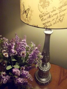 """I was please how these battered old lamps came up with a lick of silver paint and a new shade. The fact that the shade has """"Paris"""" written all over it and then large quantities of German is a little odd."""