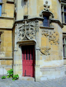 A red door in the courtyard of the Musee de Cluny
