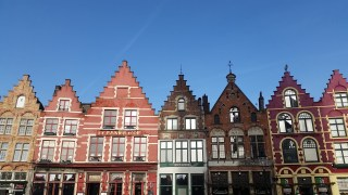 Roofs like this, called a stepped-gable, are present in cities that were prominent in the County of Flanders (e.g. Lille, Bruges, Ghent)