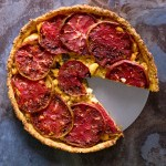 Bite-into-the-ultimate-umami-bomb-from-this-heirloom-tomato-and-ackee-tart,-baked-in-an-aged-cheddar-thyme-crust-it's-an-explosion-of-flavour-in-every-bite