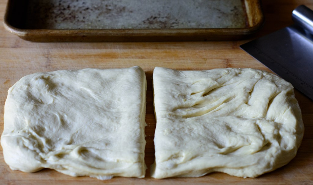 focaccia-dough-cut-in-half-in-preparation-for-making-stuffed-focaccia
