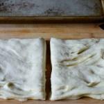 focaccia-dough-cut-in-half-in-preparation-for-making-stuffed-focaccia
