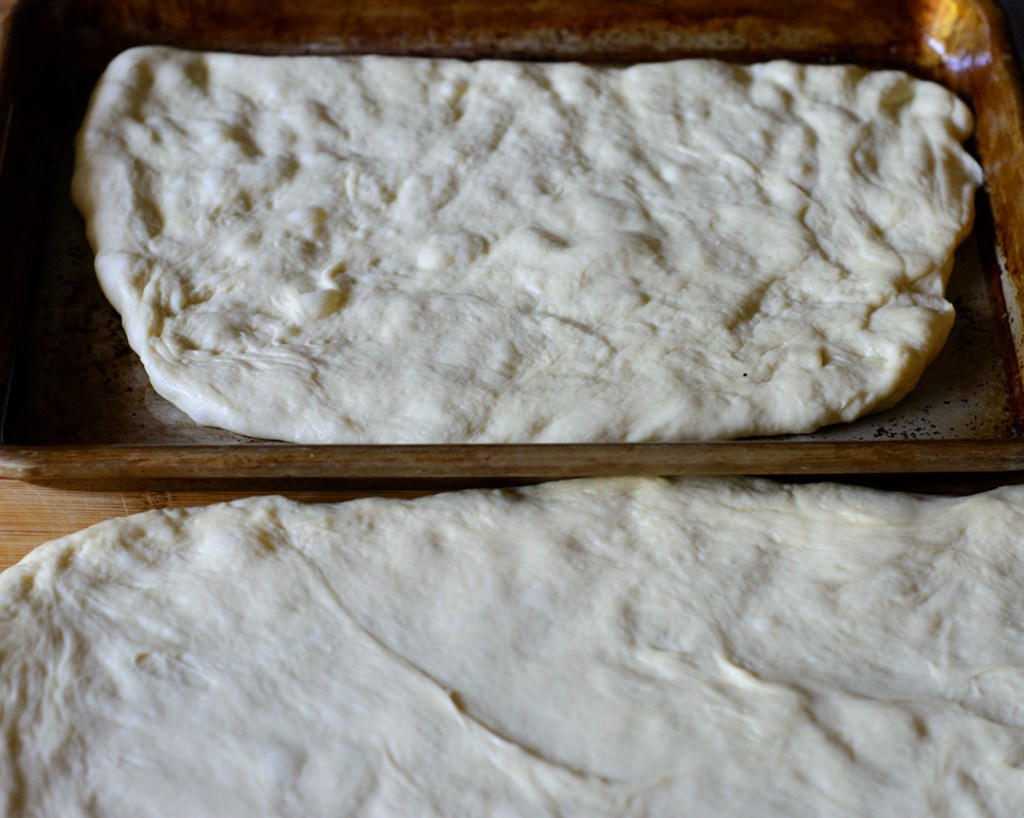 half-focaccia-dough-spread-in-pan-before-filling
