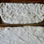 half-focaccia-dough-spread-in-pan-before-filling