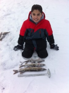 A young mind is being molded into an ice fisherman!