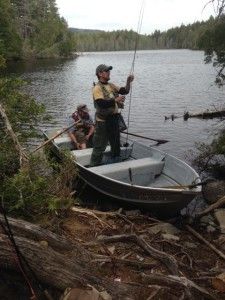 Getting ready to tackle Pickerel Pond. Three fly fishermen in a small rowboat makes for tight quarters!