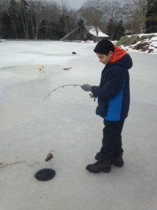 Christian jigs up a brookie. The Ice House is in the background.