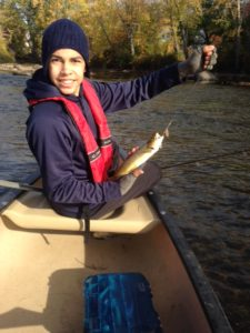 A proud angler showing off his very first brown trout ever!