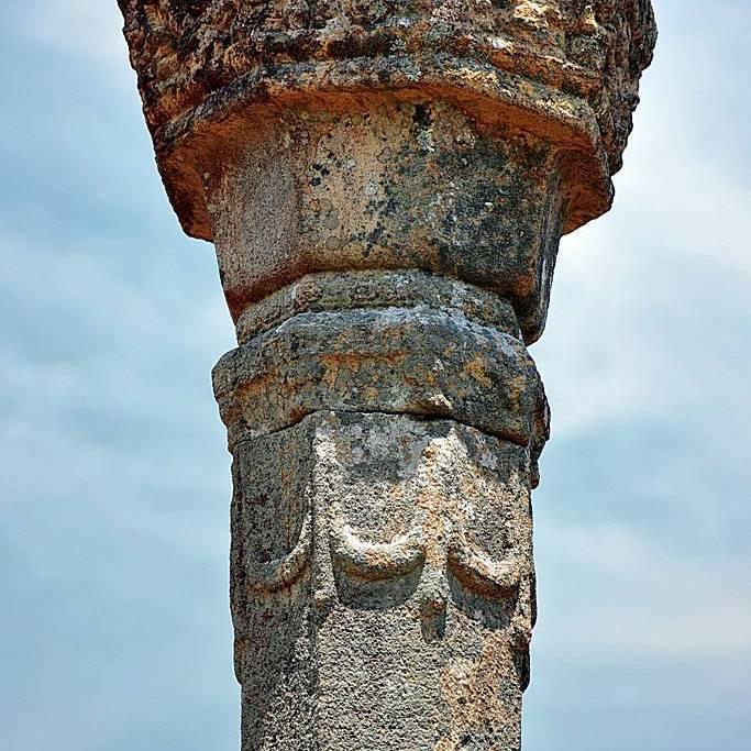 Fine decorations at the top of granite pillars which once held the roof of Medirigiriya Vatadage