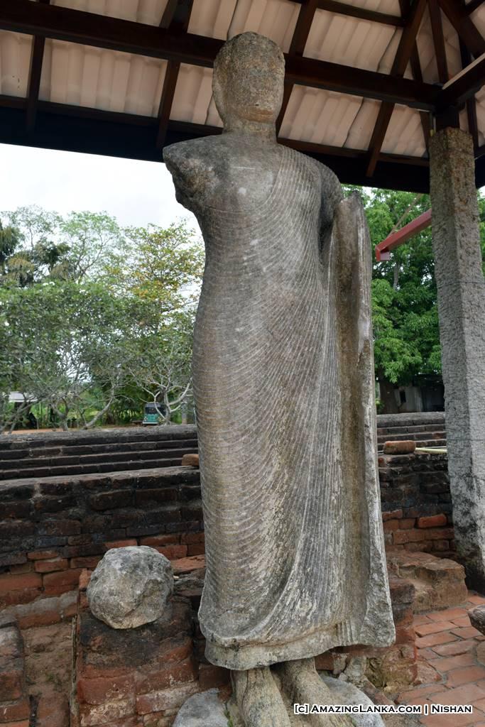 A Buddha image carved in granite at the ancient image house at Yatala Stupa in Debarawewa