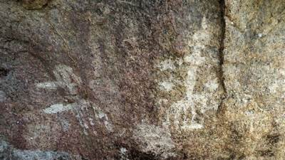 A cave right below the ruined stupa containing rock art