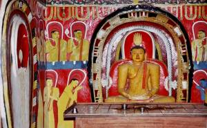 Buddha statue and murals inside the Tampita Viharaya at Hemanthagama Madiliya Rajamaha Viharaya