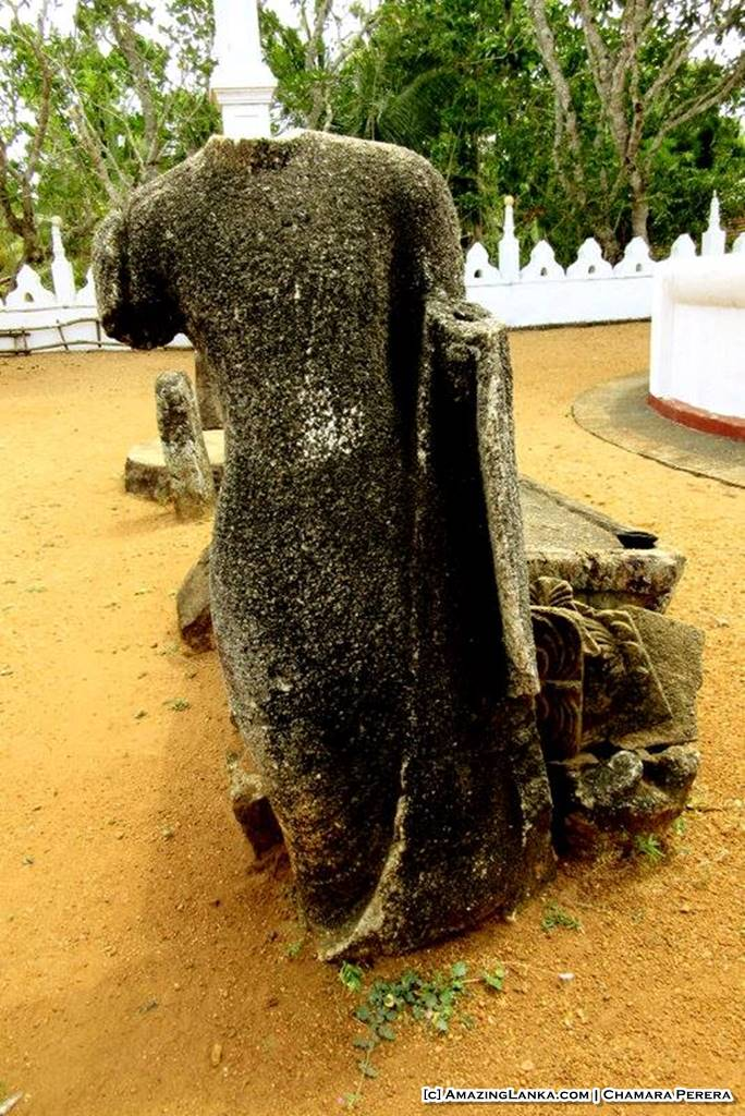 Ruins of an ancient rock carved Buddha Statue at Weragama Rajamaha Viharaya (Diya Bubule Pansala)