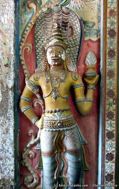 Naga Guardian deities with three hoods at the entrance to the inner chamber of Dethawa Sri Mahamuni Purana Tampita Viharaya