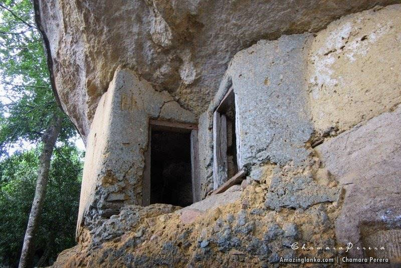 Ruins of ancient cave buildings at Nathagane Ancient Cave Temple Complex in Kurunegala