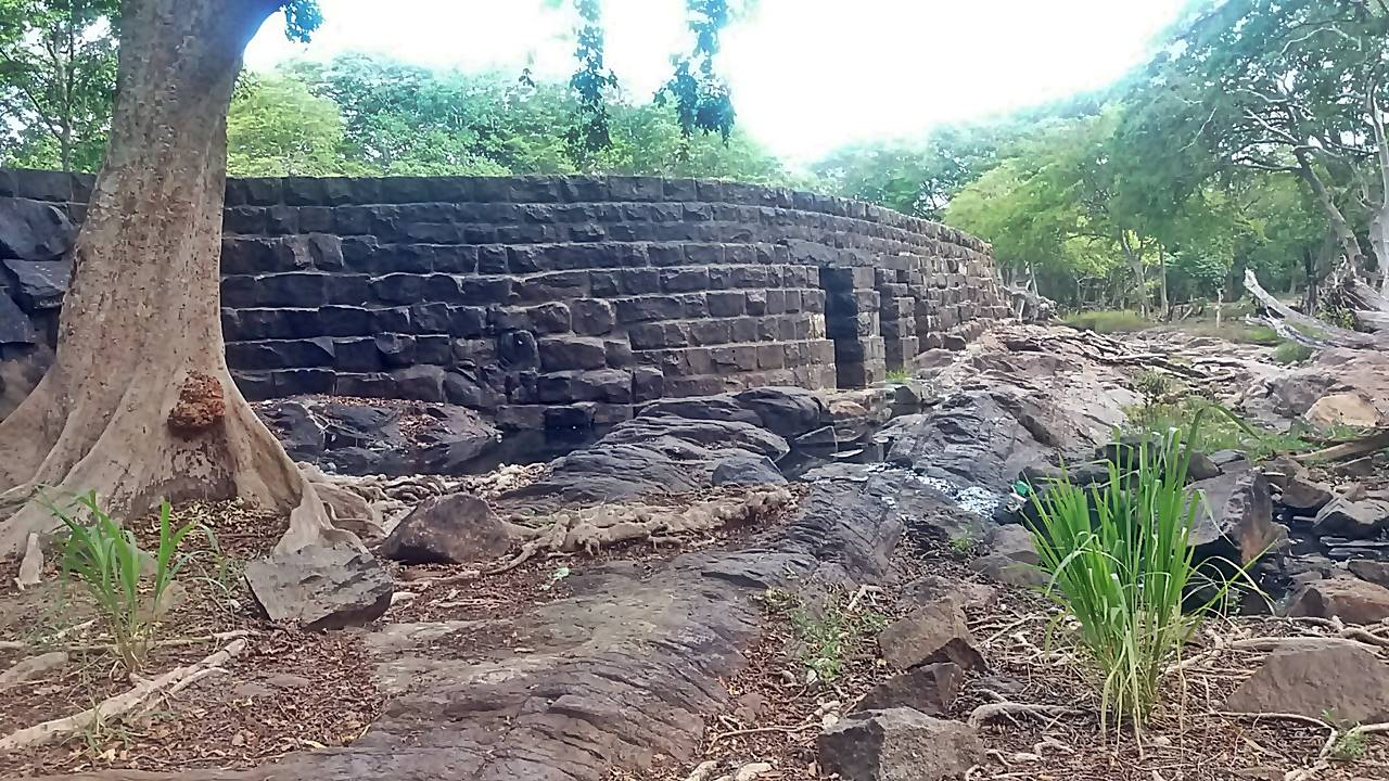 Ancient Thekkama Anicut with three openings for excess water