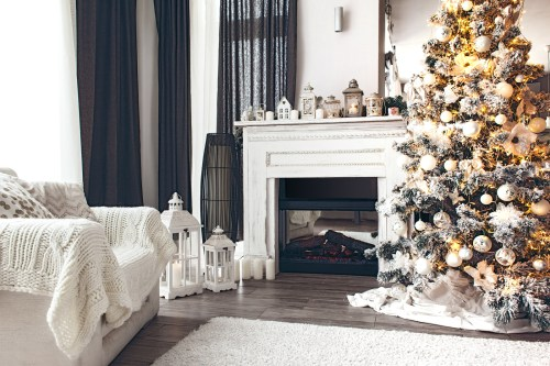 Beautiful holiday decorated room with Christmas tree, fireplace
