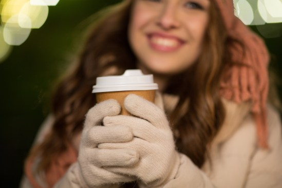 winter holidays, hot drinks and people concept - happy young wom