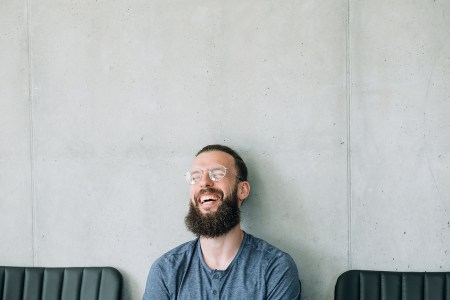 Happy Laughing Bearded Man In Glasses. Emotion Expression