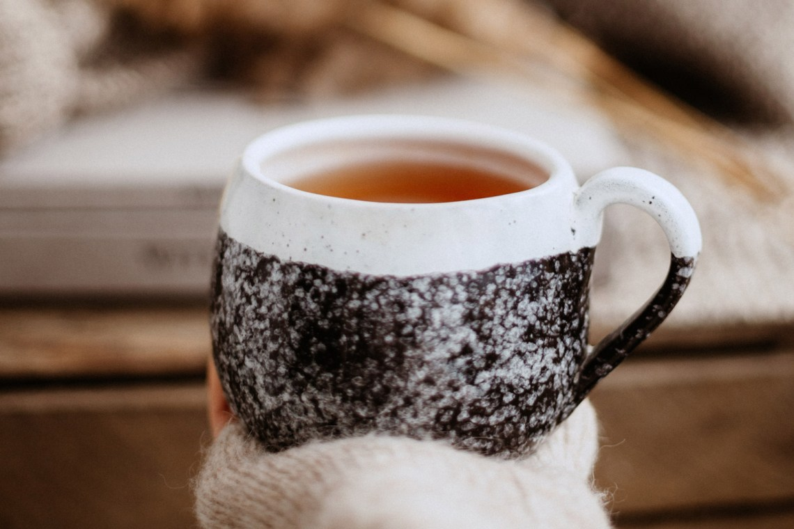Tea cup in hand relaxation