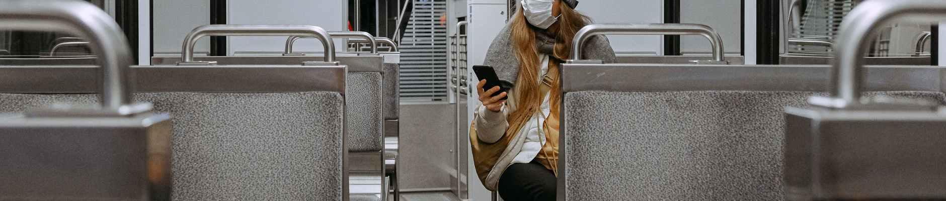 Svi se mi bojimo, woman wearing mask on train