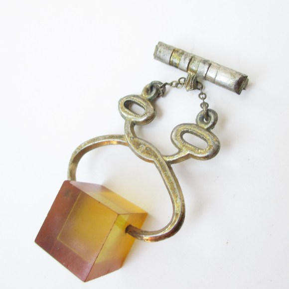 Vintage bakelite ice tongs brooch